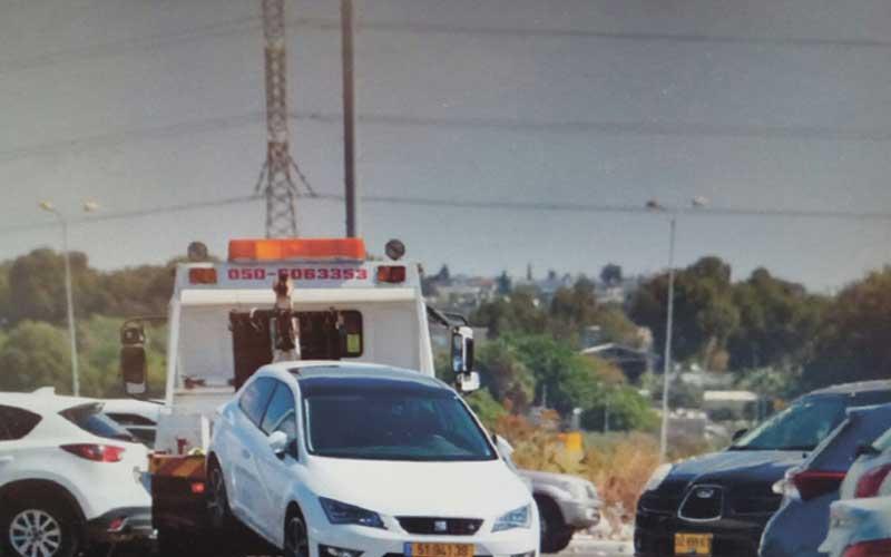 גנב מכוניות באמצעות רכב גרר. צילום: משטרת ישראל