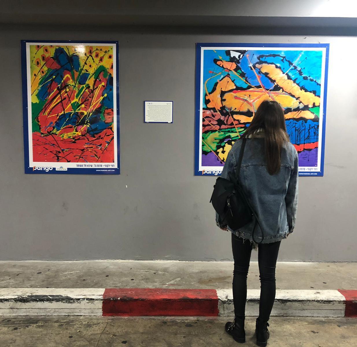 """""""ביטוי מופלא של עוצמה, נחישות וכוח רצון"""": יצירות האמנות של הלומי הקרב מוצגות בגלריה בארנה, וגם בחניון"""